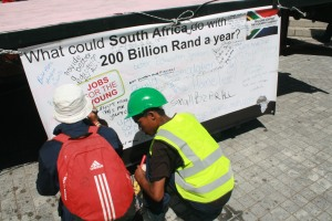 Some of the audiences writing their views on the banner.